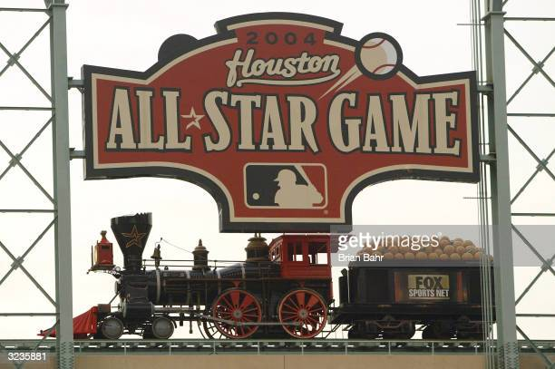 The train at Minute Maid Park passes under a sign declaring the ballpark as the site of the 2004 AllStar Game during a game between the San Francisco...
