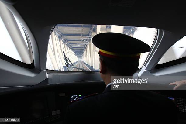 The train driver of the high speed train that runs on the new 2,298-kilometre line between Beijing and Guangzhou looks through the front window in...