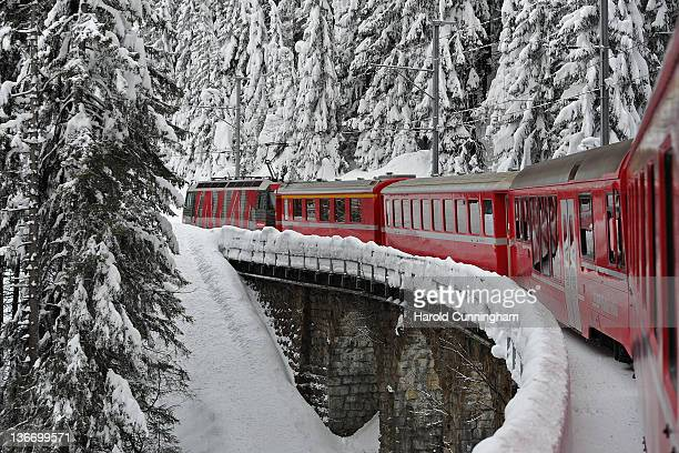 The train leading to Davos travels on snowy tracks on January 10 2012 in Davos Switzerland The World Economic Forum which gathers world top leaders...