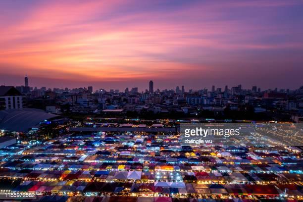 the train night market ratchada at bangkok,thailand - sunset moth stock photos and pictures