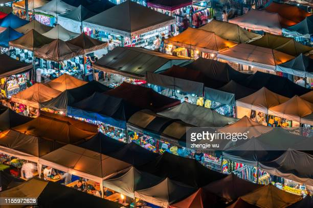the train night market ratchada at bangkok,thailand - sunset moth stock photos and pictures