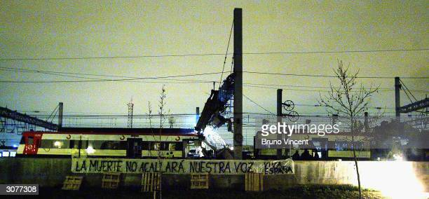 The train rocked by a bomb blast yesterday at the Atocha train station during the morning rush hour is removed from the tracks March 12 2004 in...