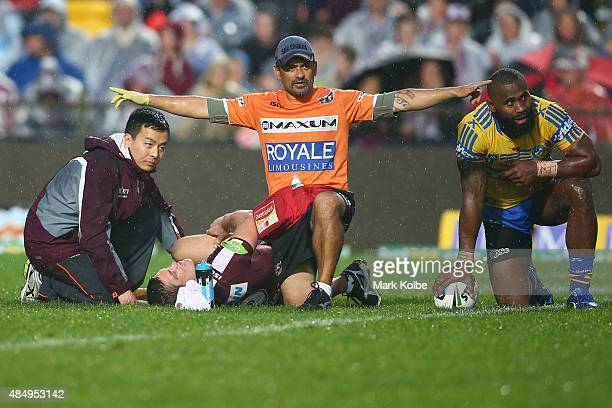The trainer calls for the stretcher for the injured Matt Ballin of the Eagles during the round 24 NRL match between the Manly Warringah Sea Eagles...