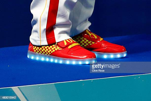 The trainers worn by Yang Sun of China are pictured as he stands on the podium during the medal ceremony after winning the gold medal in the Men's...