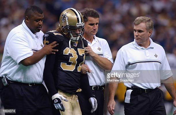 The training staff attends to safety Steve Gleason of the New Orleans Saints during the NFL game against the Pittsburgh Steelers on October 6 2002 at...