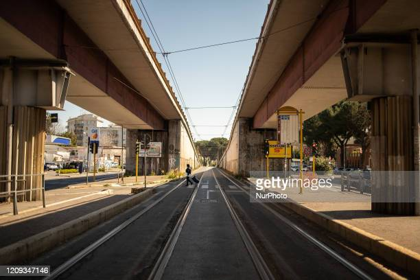The tram lines of Prenestina street appear completely deserted on April 7 2020 in Rome The Italian government has issued the nationwide lockdown...