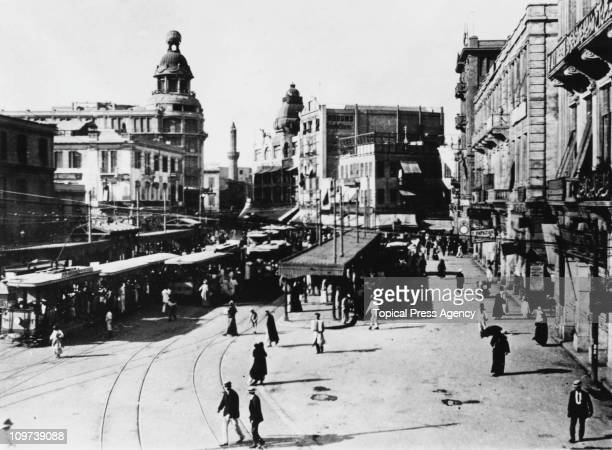 The tram station in Midan ElAtaba ElKhadra or Ataba Square in Cairo Egypt March 1919 The building on the left surmounted by a globe is the Tiring...