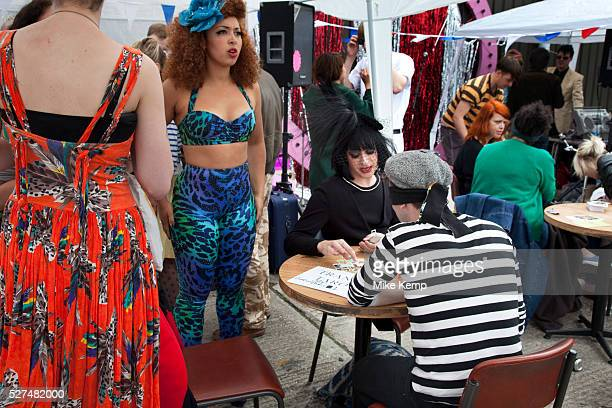 The Tranny Tarot reader The Art Car Boot Fair in a car park just off Brick Lane in East London This is an alternative art event where artists show...