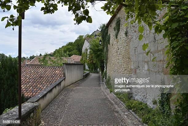 The tranquillity pedestrian walkway between old stone walls