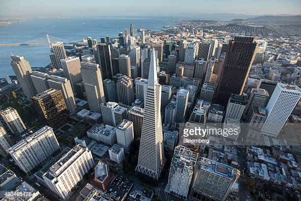 The Transamerica Pyramid building center stands in the skyline of downtown as the San FranciscoOakland Bay Bridge is seen in this aerial photograph...