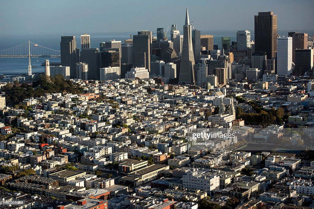 The Transamerica Pyramid building, center, stands in the skyline of downtown in this aerial photograph taken above San Francisco, California, U.S., on Monday, Oct. 5, 2015. With tech workers flooding San Francisco, one-bedroom apartment rents have climbed to $3,500 a month, more than in any other U.S. city. Photographer: David Paul Morris/Bloomberg via Getty Images