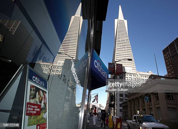 The Transamerica pyramid building is seen reflected in the window of a Citibank branch office on January 18 2011 in San Francisco California...