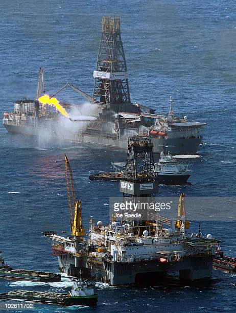 The Transocean Development Driller III and the Discoverer Enterprise drilling rig continue the effort to recover oil and cap the Deepwater Horizon...