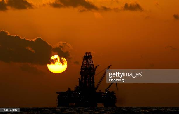 The Transocean Development Driller III leased by BP Plc is seen at sunset as it works to drill a backup relief well at the BP Plc Macondo well site...