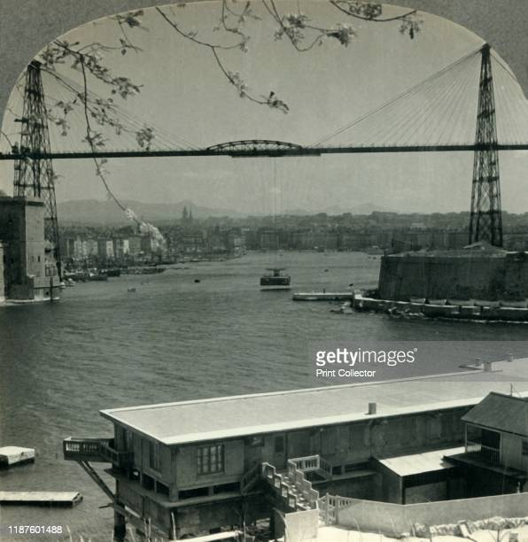 The Transporter Bridge and Entrance to Old Harbor Marseilles France' circa 1930s From Tour of the World [Keystone View Company Meadville Pa New York...