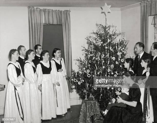 The Trapp Family on Christmas eve Photograph Around 1941 [Die Trapp Familie an Weihnachten Photographie sterreich Um 1941]