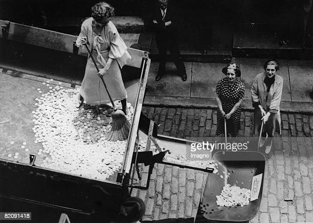The travel of money In the streets of Philadelphia coins are being distributed to boost the cash flow Photograph America Around 1930 [Die Reise des...