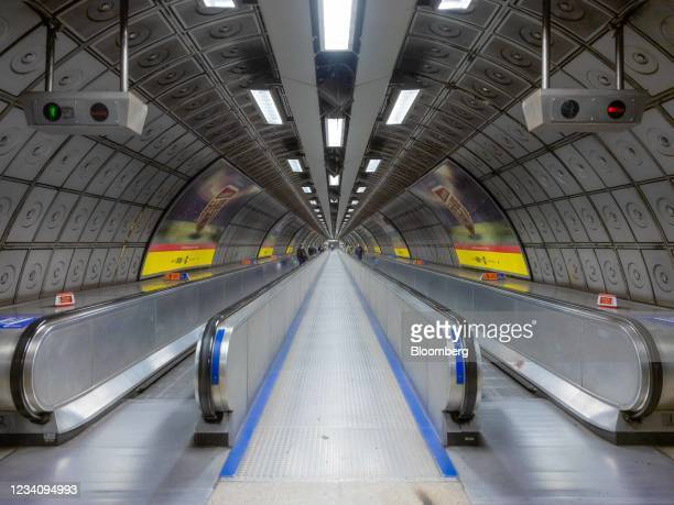 The travelator at Waterloo Underground station in London, U.K., on Friday, July 9, 2021. With the vast majority of the Square Miles 500,000 office...