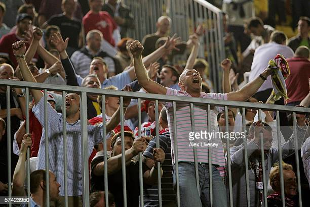 The travelling Arsenal fans celebrate after the final whistle during the Champions League Semi Final Second Leg match between Villarreal and Arsenal...