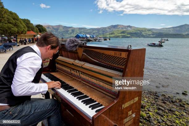 The travelling pianist at work on Akaroa Harbour waterfront