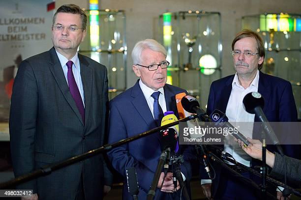 The treasurer of German Football Association Reinhard Grindel, DFB co-interim presidents Reinhard Rauball and Rainer Koch speak to the media after...