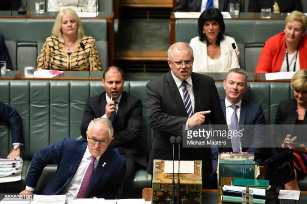 The Treasurer Scott Morrison answers a questions during Question Time in House of Representatives at Parliament House on December 5 2017 in Canberra...