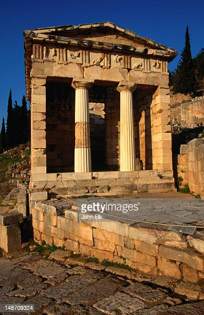 The Treasury of the Athenians with its two Doric columns and carved entablature is the best preserved building in the Sanctuary of Apollo.