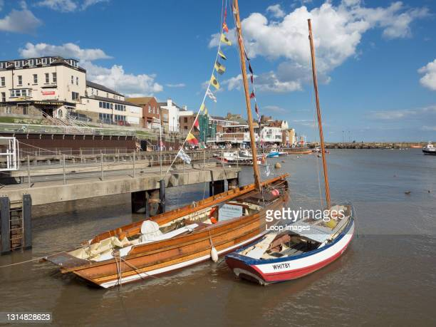 The Tree Brothers coble boat in Bridlington harbour on the Yorkshire coast.
