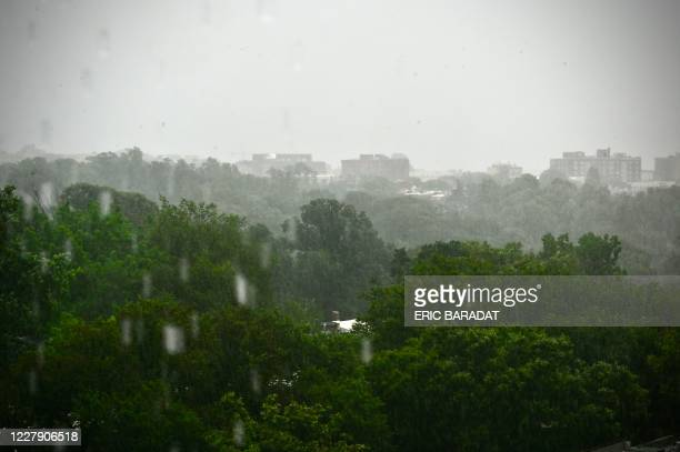 The tree line of Rock Creek Park is seen under heavy rain as Tropical Storm Isaias hits the Washington DC area on August 4 2020 Hurricane Isaias...