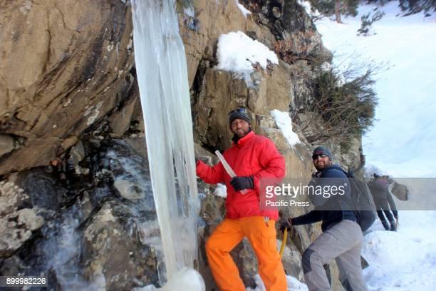 The trekkers walked around frozen waterfall at Chandanwari in Pahalgam