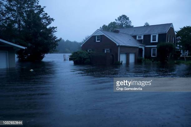 The Trent River overflows its banks and floods a neighborhood during Hurricane Florence September 13 2018 in River Bend North Carolina Some parts of...