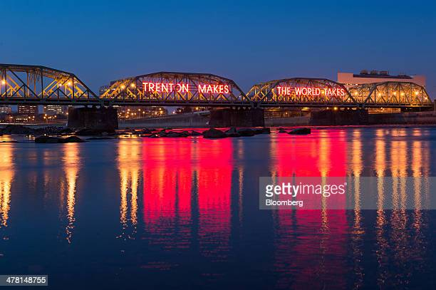 The Trenton Makes The World Takes sign displayed on the Lower Trenton Bridge is reflected in the water seen from the Pennsylvania side of the...