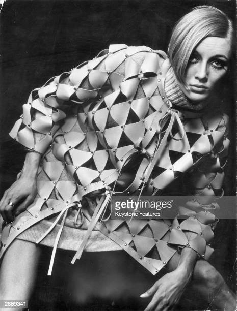 The triangular pieces of leather are nailed together in this coat designed by Paco Rabanne giving an appearance of chainmail armour