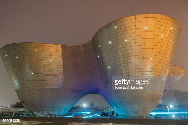 the tri-bowl building at songdo central park at the financial district of incheon, south korea in the evening. - songdo ibd stock pictures, royalty-free photos & images