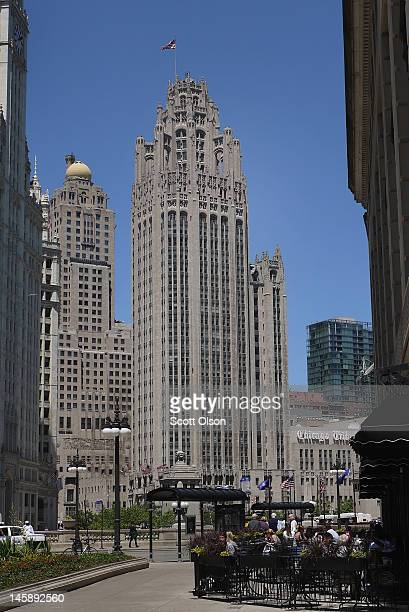 The Tribune Tower headquarters of the Tribune Company rises above diners having lunch along Wacker Drive on June 7 2012 in Chicago Illinois The...