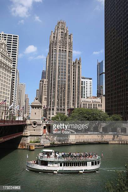 The Tribune Tower home of the Chicago Tribune WGN Radio and the Tribune Company sits along Michigan Avenue near the Chicago River on July 10 2013 in...