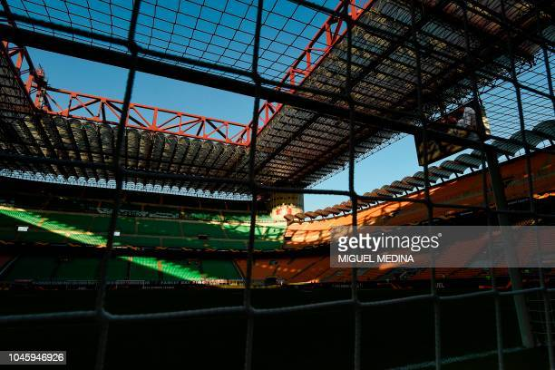 The tribunes and roof of the San Siro stadium in Milan are pictured on October 4, 2018 prior to the Europa League Group F football match between AC...