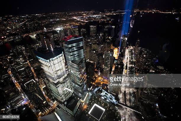 The 'Tribute in Light' illuminates the night sky of Lower Manhattan as seen from the observatory in One World Trade Center September 11 2016 in New...