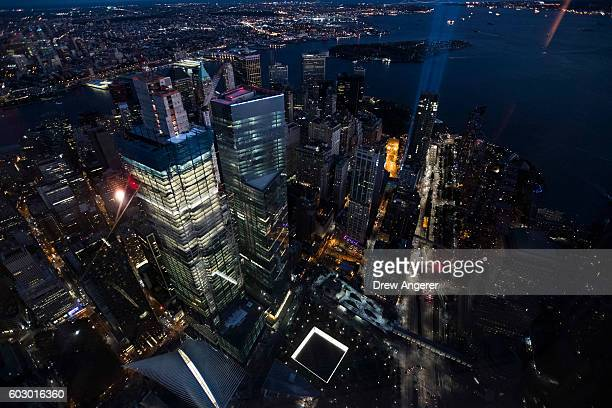 The Tribute in Light illuminates the night sky of Lower Manhattan as seen from the observatory in One World Trade Center September 11 2016 in New...