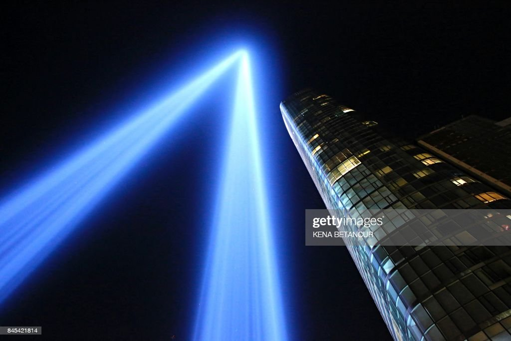 TOPSHOT - The 'Tribute in Light' illuminates the night sky, on September 10, 2017 in New York City, on the eve of the anniversary of the September 11, 2001 terror attacks. /