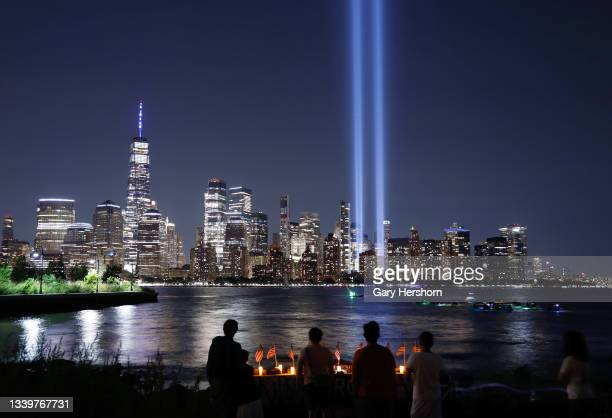 The Tribute in Light is illuminated above lower Manhattan and One World Trade Center in New York City on the 20th anniversary of the 9/11 attacks on...
