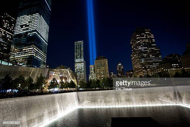 The Tribute in Light is seen over the 9/11 Memorial September 11 2014 in New York This year marks the 13th anniversary of the September 11th...