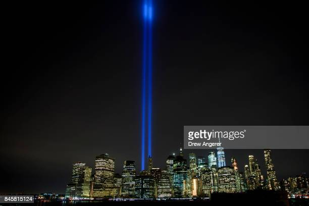 The 'Tribute in Light' rises above the skyline of Lower Manhattan as seen from the Brooklyn Heights Promenade September 11 2017 in New York City In...