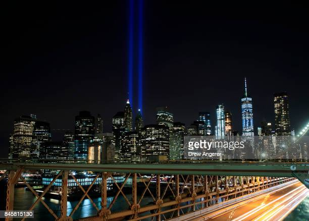 The 'Tribute in Light' rises above the skyline of Lower Manhattan as seen from the Brooklyn Bridge September 11 2017 in New York City In New York...