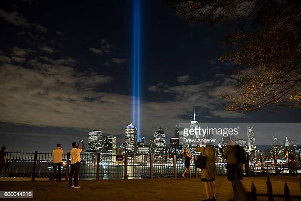 The 'Tribute in Light' rises from the Lower Manhattan skyline as seen from the Brooklyn Heights Promenade, September 7, 2016 in the Brooklyn borough...