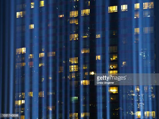 The 'Tribute in Light' rises skyward in Lower Manhattan September 11 2018 in New York City In New York City and throughout the United States the...