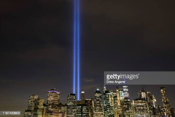The 'Tribute in Light' rises skyward on the 18th anniversary of the 9/11 terrorist attacks September 11 2019 in New York City Throughout the United...