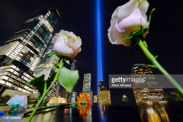 The 'Tribute in Light' seen from the bronze parapet surrounding the North Pool rises skyward on the 18th anniversary of the 9/11 terrorist attacks...