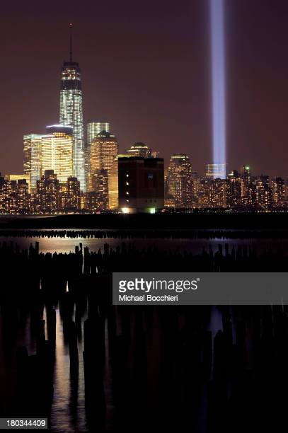 The 'Tribute in Light' shines from the Manhattan skyline next to One World Trade Center to commemorate all those who were lost on 9/11 on September...