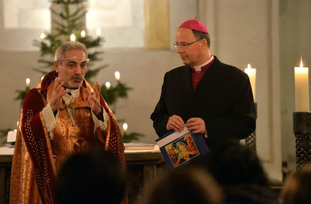 Syrian priest holds catholic mass in arabic pictures getty images syrian priest holds catholic mass in arabic m4hsunfo